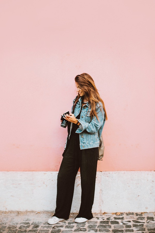 transition-your-summer-wardrobe-to-fall-woman-denim-jacket-black-jumpsuit