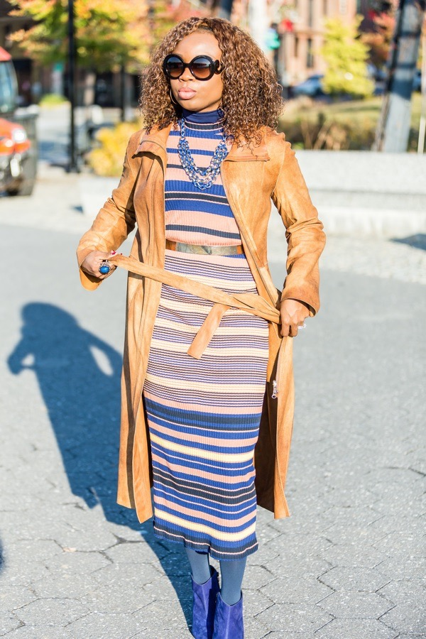 transition-your-summer-wardrobe-to-fall-woman-long-leather-jacket-over-sweater-dress