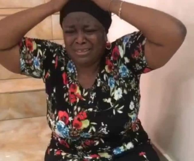 VIDEO: Mike Adenugu's Mistress Cries In Pain As EFCC Tries Evict Her