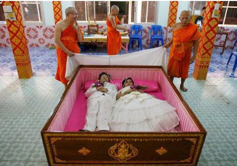 WHAT IS GOING ON HERE? See How Couples Perform Their Marriage Rites Inside A Coffin in Thailand
