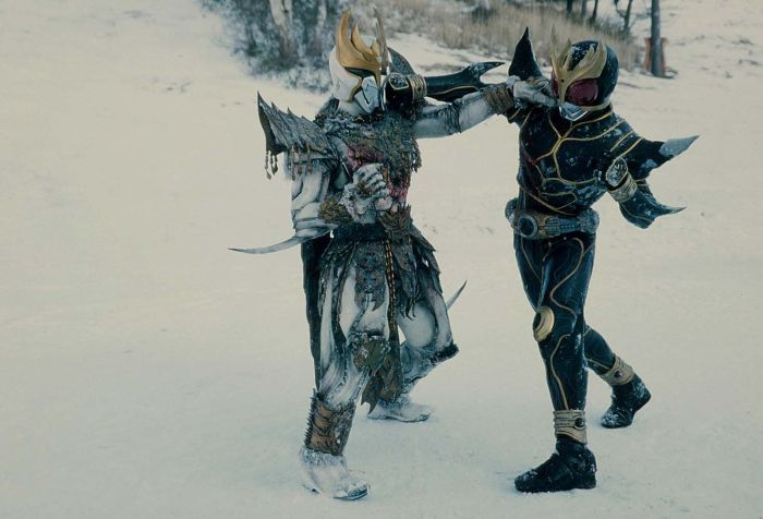 N-Daguva-Zeba and Kamen Rider Kuuga's final fight. They are both punching each other in the face atop a snowy landscape.