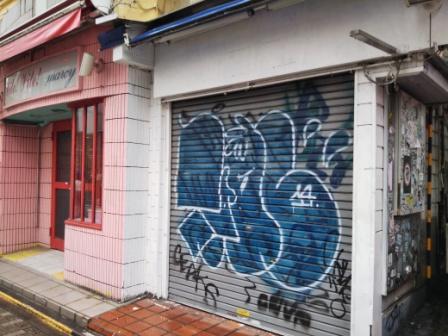 shuttered shops and graffiti