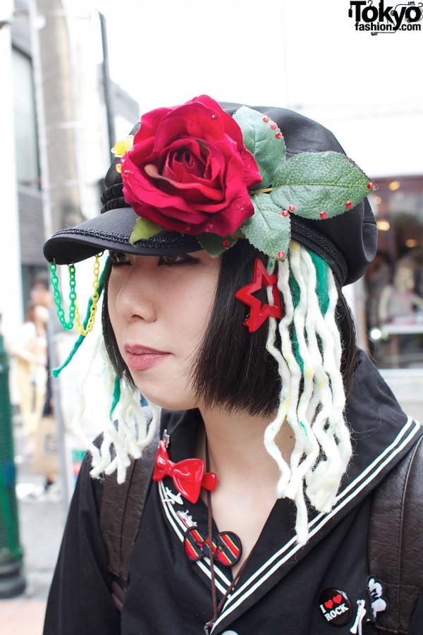 Leather cap, rose & yarn