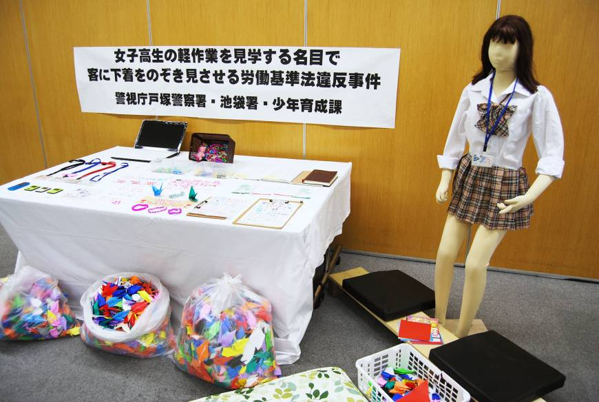 Thriving trade: Bags of origami cranes apparently folded by girls at Minna no Sagyojo Kurione and other evidence collected by police from the 'workshop' in Higashi-Ikebukuro are revealed to reporters earlier this month in Tokyo. | KYODO