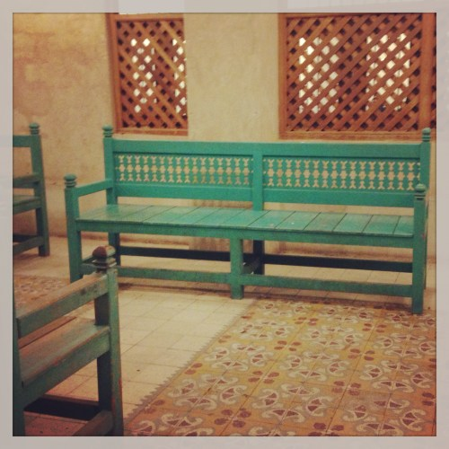 green bench at the souq