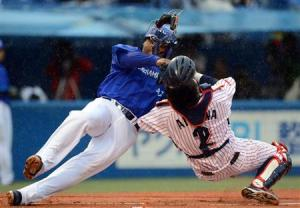 Tony Blanco collides with Aikawa at home plate.