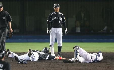 Aftermath of R. Arai collision with Nakamura. Arai was called safe on the play.