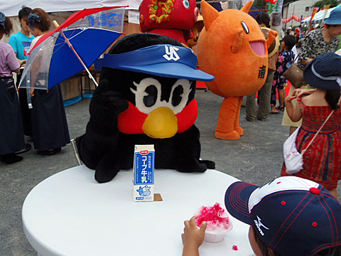Tsubami asking a child for advice on how to improve the team.