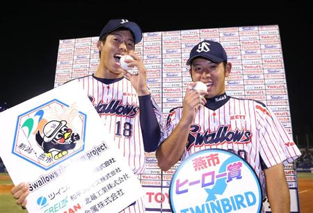 Sugiura shows off a ball from his first win, and Nishida shows off his first home run ball.