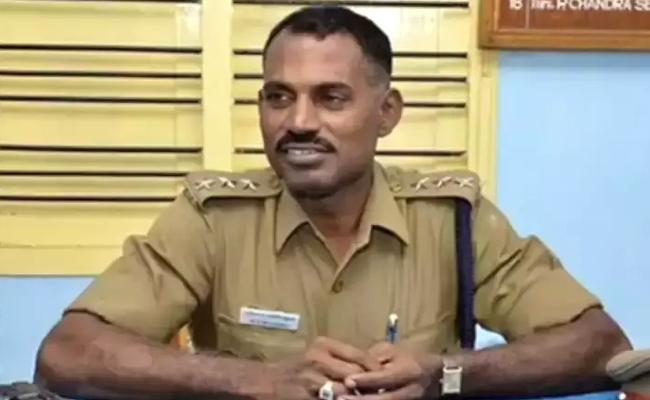 Tamil Nadu Assembly Polls Cop Transfer While His Wife Contesting In Elections - Sakshi