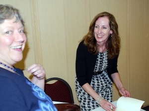 Novelist Susan Schoenberger, right, signed a book while Foundation director Betty-Lou Griffin looked on.