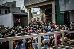 A view from the top of the pickup as we travel through downtown Port-au-Prince. We believe the crowd was gathered around a location so they could receive aid. While many people have come a long way in their recovery since the 2010 earthquake, there is still much more that can be done.