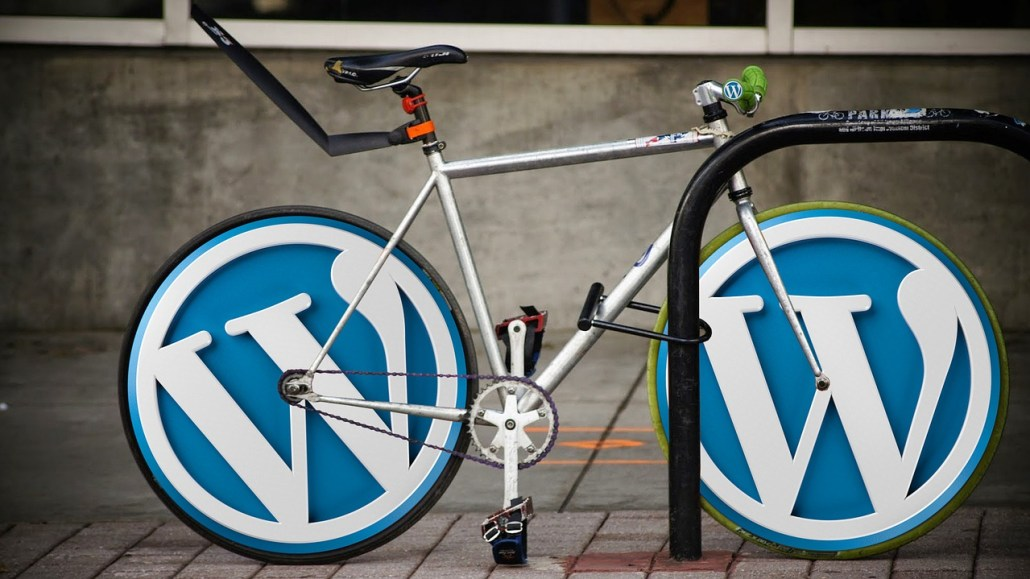 A bicycle with the logo of WordPress on the wheels