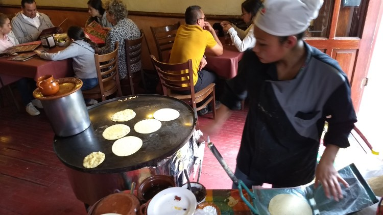 Making tortillas by hand in a restaurant.