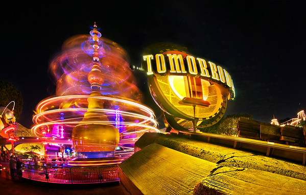 Astro Orbiter spins at night in the entranceway to Tomorrowland. See tons more photos from this, our first Disneyland trip here: https://www.disneytouristblog.com/disneyland-disney-california-adventure-august-2010-trip-report/