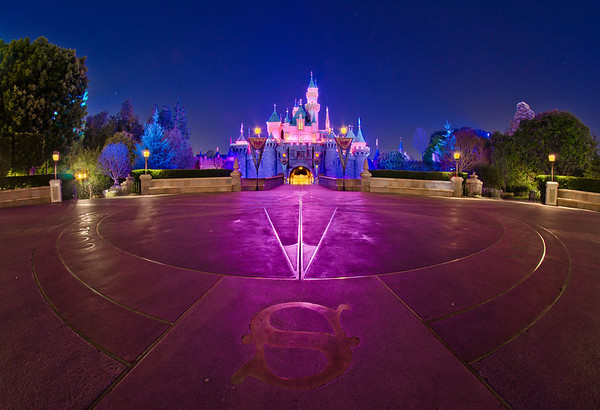 When the crowds have cleared, a Compass Rose is visible on the ground in front of Sleeping Beauty Castle at Disneyland. Photo taken with a Rokinon 8mm fisheye lens.Lens review: https://www.disneytouristblog.com/8mm-fisheye-samyang-rokinon-lens-review/