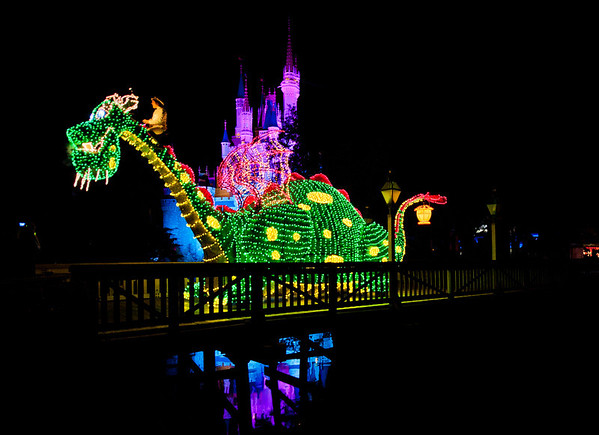 Pete and his dragon, Elliott, in the Main Street Electrical Parade! For more MSEP photos, visit: https://www.disneytouristblog.com/main-street-electrical-parade-disney-world-photos/