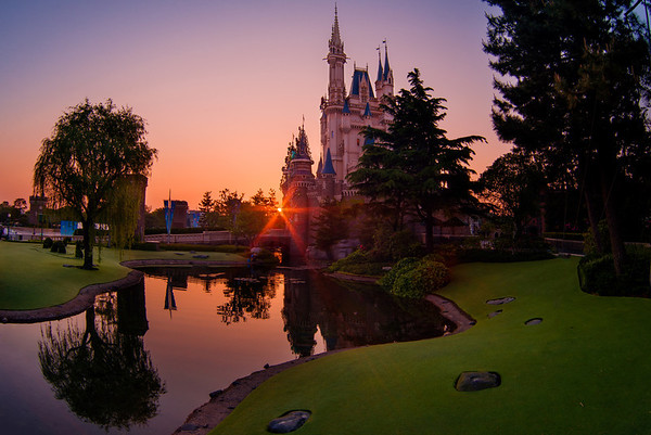 Sunrise over Cinderella Castle at Tokyo Disneyland. This is actually the inverse of my #1 Cinderella Castle photo spot in the Magic Kingdom (and is probably my #1 photo spot in Tokyo). Top 10 Cinderella Castle Photo Spots: https://www.disneytouristblog.com/cinderella-castle-photo-spots/