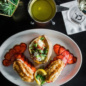 Seafood delicacy twin lobster tails seasoned and broiled