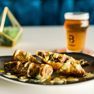 Fried egg roll stuffed with pulled pork and collard greens - Mean Green Eggrolls a TB signature dish