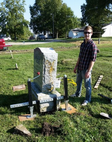 Tombstone Jack lifting headstone