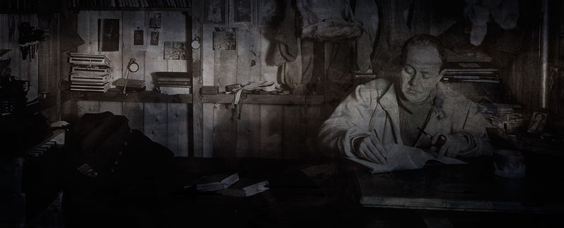 Robert Falcon Scott writing in his journal, at Scott's Hut Antarctica.