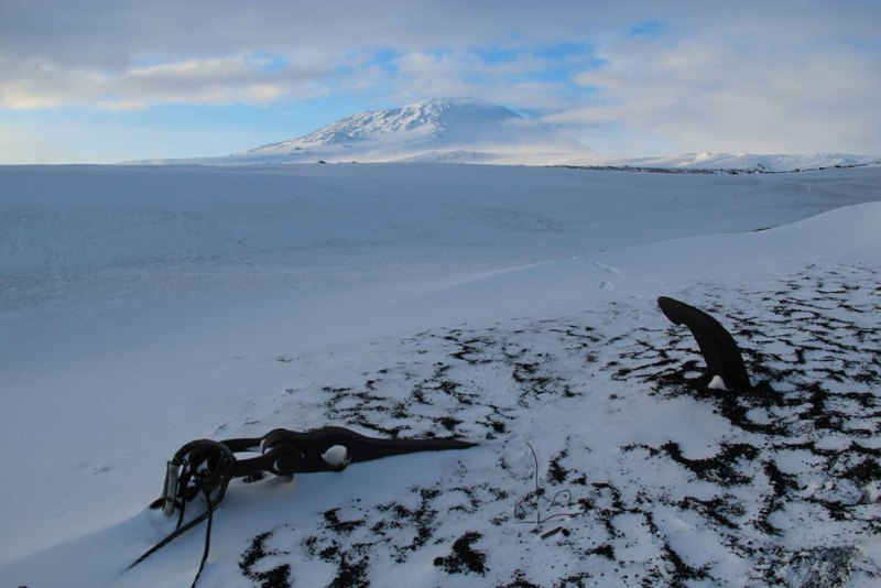 Anchor from the Aurora (Shackleton's Ross Sea Party) and Erebus Robert Falcon Scott's Terra Nova Hut, Cape Evans Antarctica, September 2013