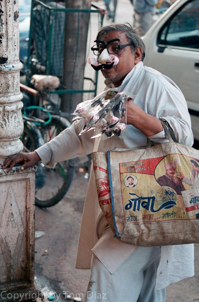 """The Groucho Merchant."" Chandi Chowk bazaar, Delhi, India, Novermber 2003."