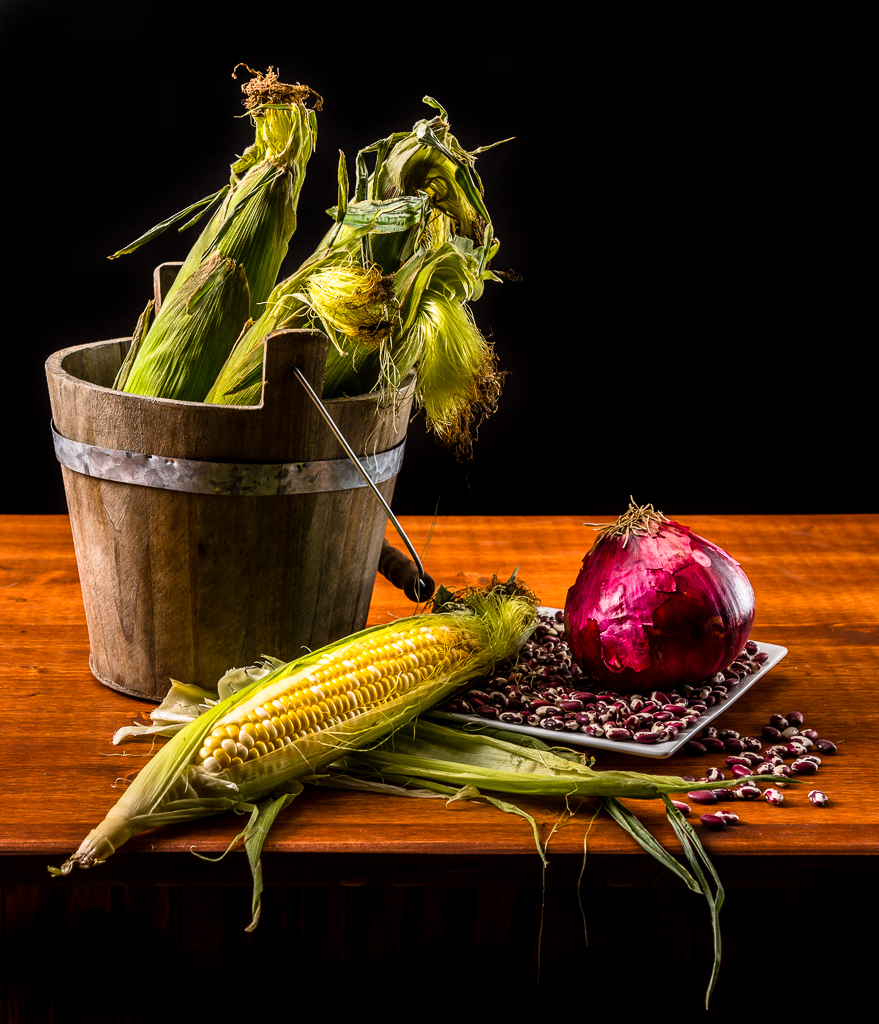 Early vesion of still life of corn, beans, and onion.