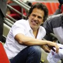 Tom Gores poses with a fan at a Pistons game, Tom Gores, Pistons Owner, Platinum Equity CEO