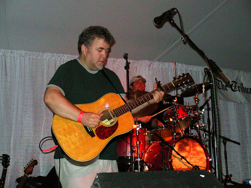 onstage with mike beeson behind dan may