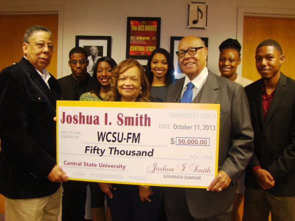 (First row, far right) 1963 CSU Alumnus Joshua I. Smith presented WCSU-FM with a check for $50,000 during homecoming festivities to ensure resources are available for the only minority-owned and operated non-commercial, Ohio public radio station broadcasting in the state.