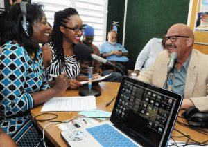 Tom Joyner interviewed by Manefa O'Connor-Francis, left, and Marisha J. Jno-Lewis at WUVI's student radio station WUVI – 1090 AM, which airs the Tom Joyner Morning Show.