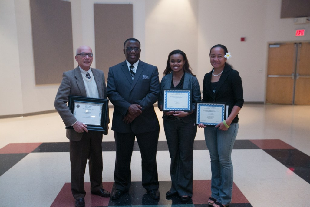 Donald Staffo, Interim President Peter E. Millet, Elizabeth Caver and Litia Godinet are pictured at the Research Symposium where Staffo, Caver and Godinet received awards.