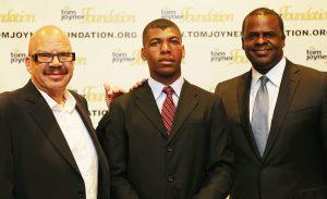 Titus Zeigler (c) with Tom Joyner (l) and Atlanta Mayor Kasim Reed (r)