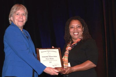 Hoskins, right, accepts the 2015 Emmaline Moore Prize from AFS