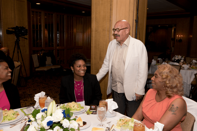 TJF Founder Tom Joyner speaks with Full Ride Scholarship banquet attendees. (Photo: Jesse Hornbuckle)