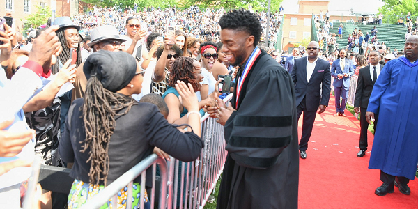 Chadwick Boseman stops to greet the audience along the processional route during Howard University's 150th Commencement Ceremony on Saturday, May 12, 2018 in Washington, D.C. (Photo: Courtesy of Howard University)
