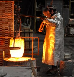 A pot of hot bronze pulled from the furnace and ready to pour.
