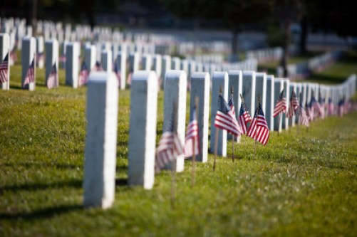 flags-headstones-cemetery