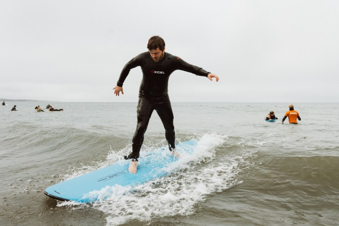 Student surfing in group lesson