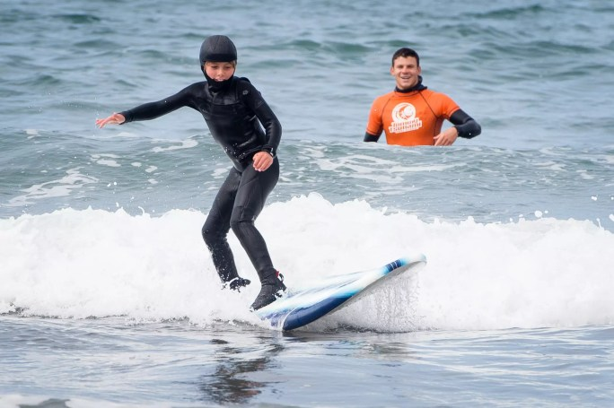young boy surfing