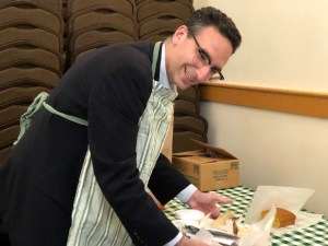 Tommy Vitolo serving food at the Young Israel Green Street BBQ