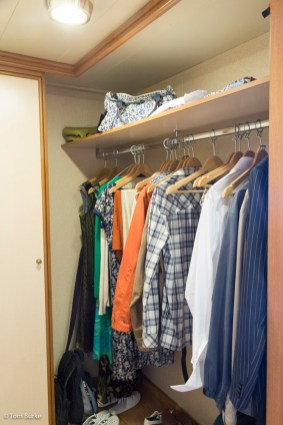 The walk-in clothes hanging area