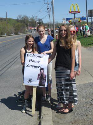 Girls Holding Sawyer Fredericks Sign