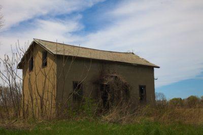 abandoned-stucco-house