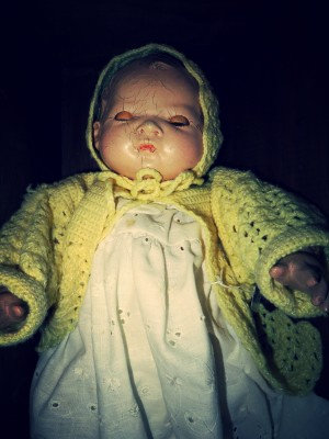 baby-doll-in-a-wooden-box