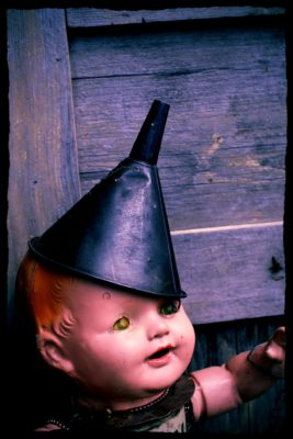 creepy-doll-with-metal-funnel