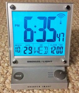 Picture of the Sharper Image LCD atomic alarm clock, front view.