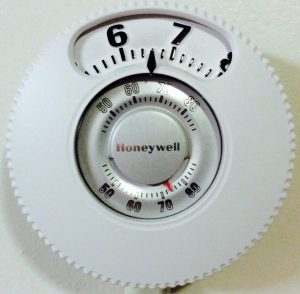 Picture of the installed Honeywell Large Dial Thermostat, T87N1026.
